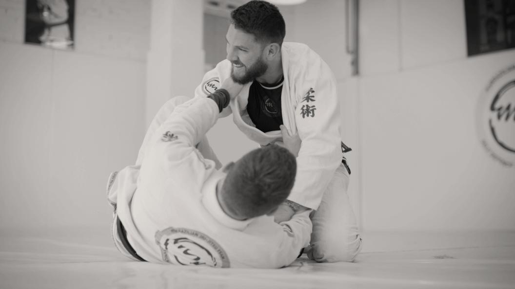 Two men practicing martial arts.